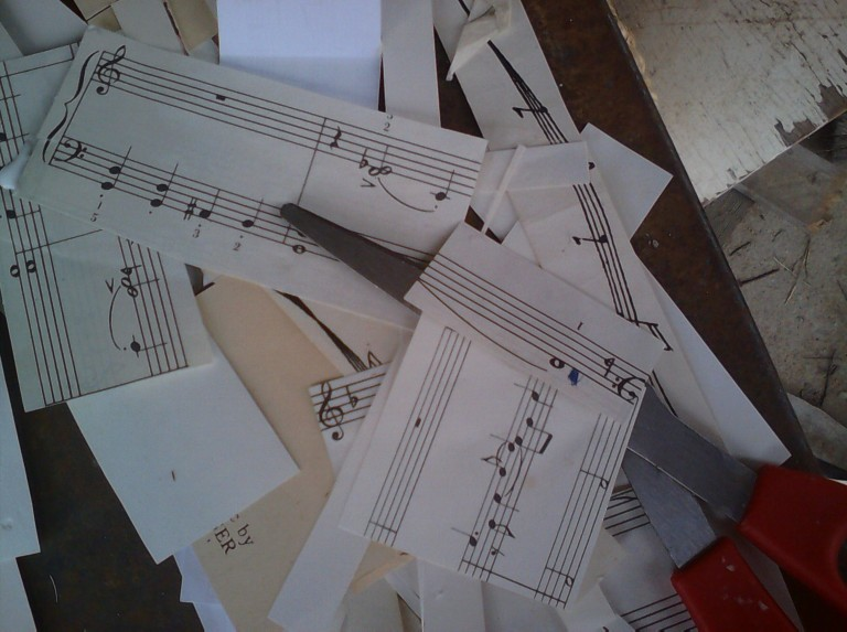 I cut up a bunch of vintage sheet music to use for the clock body